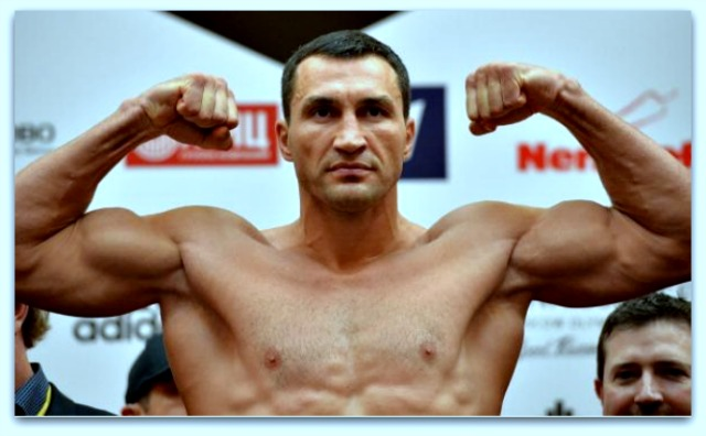 Wladimir Klitschko, the Ukrainian three-belt world champion, poses for photos at an official weigh-in in Moscow, Russia. Photo: Epsilon/Getty Images