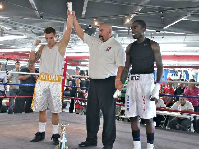 After defeating Jermaine Powell of the Febela Chavez Boxing Club in Bout #10, the winner, David Vasconcellos (L) of South Coast Boxing has his arm raised in victory by referee Hondo Fontan