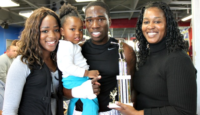 At the conclusion of his bout with David Vasconcellos, Jermaine Powell is joined by his proud family.