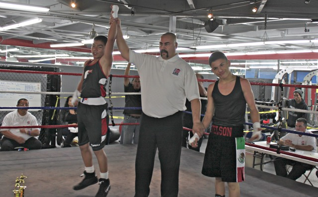 In Bout #11 it was Ramon Gonzales (L) unattached getting the victory over Nelson Salazar of the Sons of God Boxing Club.