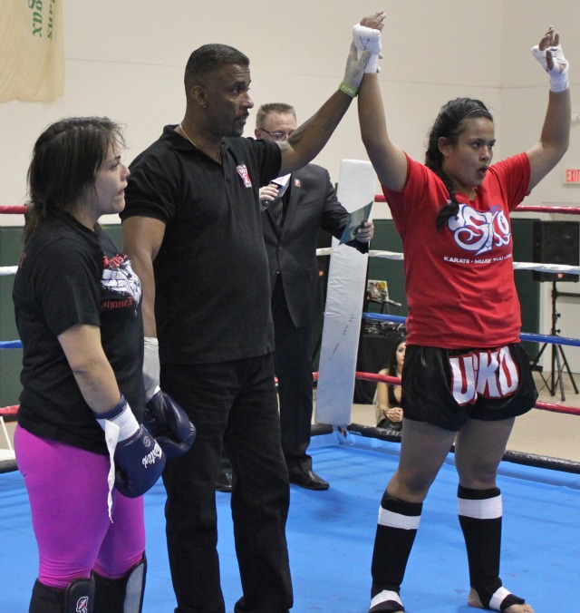 Bout #1, Alejandra Placencia (R) has her hand raised in victory by referee George Valdez after she defeated Ariel Hunt in bout #1