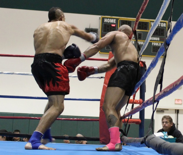 Bradly Guachino (L) is shown landing a big overhand right to the head of Andrew Gabriel