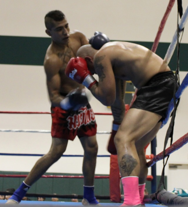 Bradly Guachino uses a stiff uppercut on his opponent Andrew Gabriel in Saturday evening's Main Event at the Pala Recreation Center in Pala, CA. Photo: Jim Wyatt