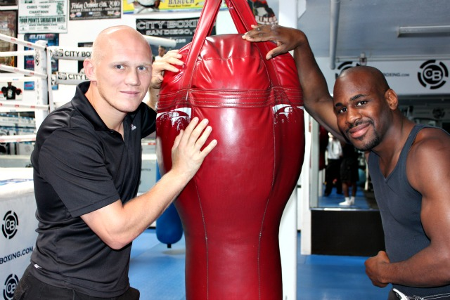 In their 14th Street gym, City Boxing Downtown, Denis Grachev and fellow pugilist Chris Chatman take a moment to pose for a photo.