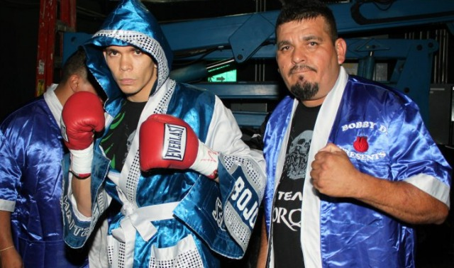 Christian Bojorquez poses for a photo with his father and trainer. Photo: Jim Wyatt
