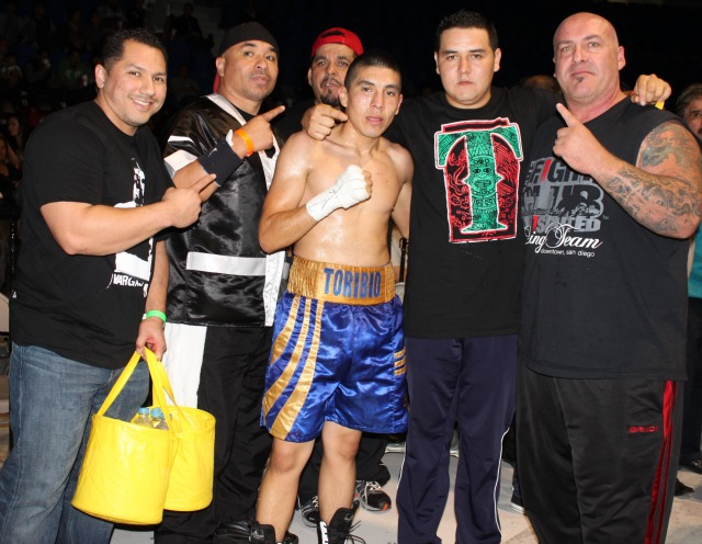 Jose Toribio (center) poses for a photo with his  support group. Photo: Jim Wyatt