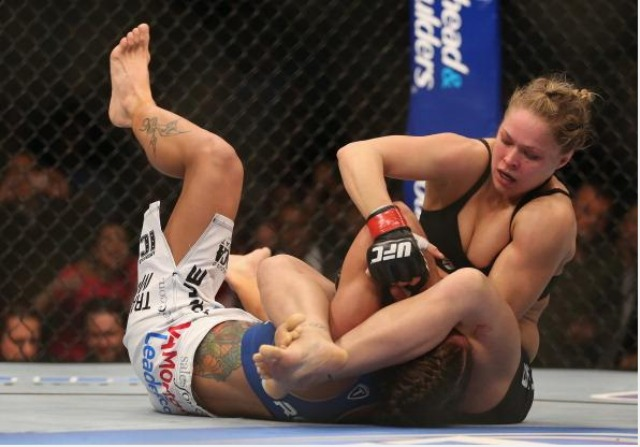 Ronda Rousey battles Liz Carmouche during their UFC Bantamweight Title bout at Honda Center on February 23, 2013 in Anaheim, CA. Photo: Jeff Gross/Getty Images