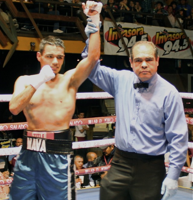 Daniel Nava has his arm raised in victory after wins the split decision victory over Carlos Rivera.