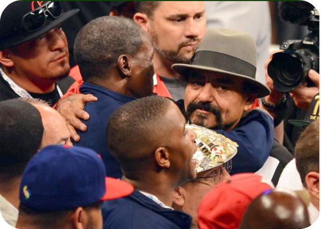 You don't have to get your eyes checked. After their sons fought on Saturday Floyd Mayweather Sr. wrapped his arms around la papa of Robert Guerrero, Ruben Guerrero. Photo: Al Bello/Getty Images