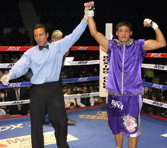 At the conclusion of Bout #3, Victor Fonseca (r) has his arm raised in victory by referee Christian Curiel.