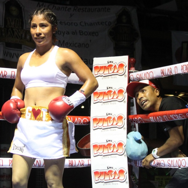The formidable, majestic, undefeated Kenia Enriguez (7-0, 4 KOs) of Tijuana looks across the ring at her opponent Gloria Salas (3-8-1) of Palm Springs, CA.