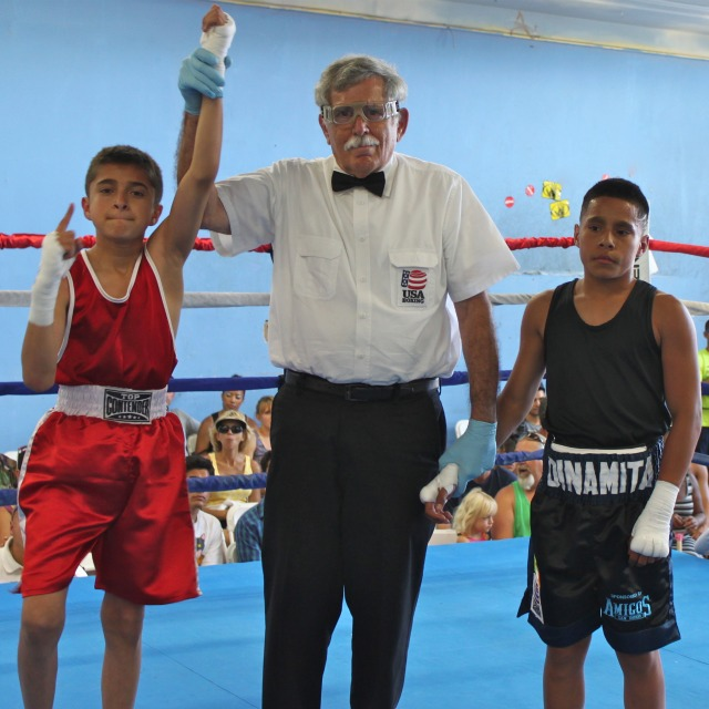 Jose Chollet (l) has his arm raised in victory by referee Will White after defeating Gilbert Roybal. All photos: Jim Wyatt