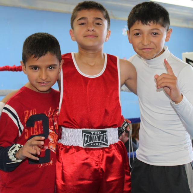 Jose Chollet's two brothers, also USA Amateur boxers, join him for a photo at the conclusion of his bout.