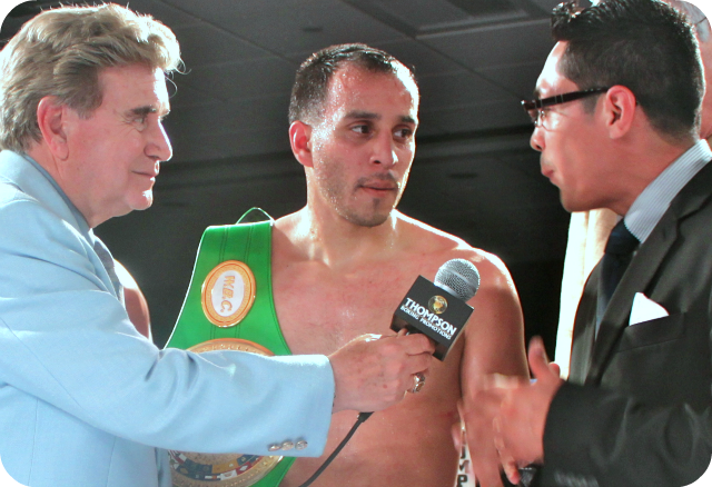 "The former super bantamweight champion of the world, now Gym owner and ringside commentator, Israel Vasquez (r) interviews Chris ""Marvelous"" Martin of Chula Vista, CA (c) after his TKO win over Raul ""Bule"" Hidalgo of Casas Grandes, Chihuahua, Mexico. All photos: Jim Wyatt"