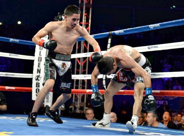 In the co-feature, Leo Santa Cruz (l) knocks Victor Terrazas down, the first of two knockdowns in his three round knockout victory during their WBC Super Bantamweight Title Fight. Photo: Harry How/Getty Images