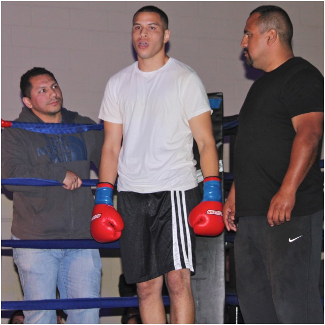 With his entourage to include his trainer Joe Vargas (r) Ulises Sierra (c) makes his way to the ring for his bout against Christenberry.