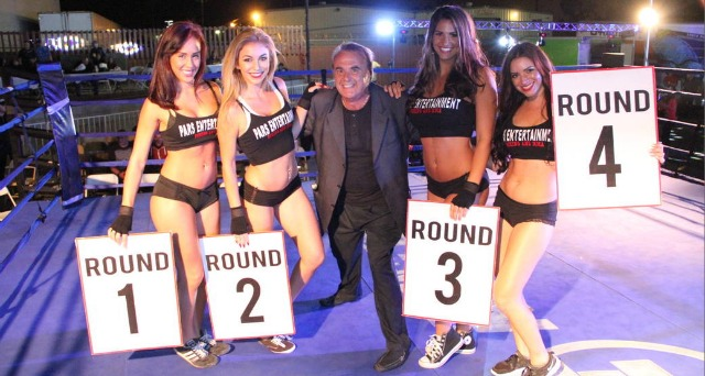 On Saturday night, Gino Carpinelli, the Escondido World Market Place's promoter extraordinaire, could not refuse the request from the lovely ring card girls to have a photo with the maestro of North County marketing.