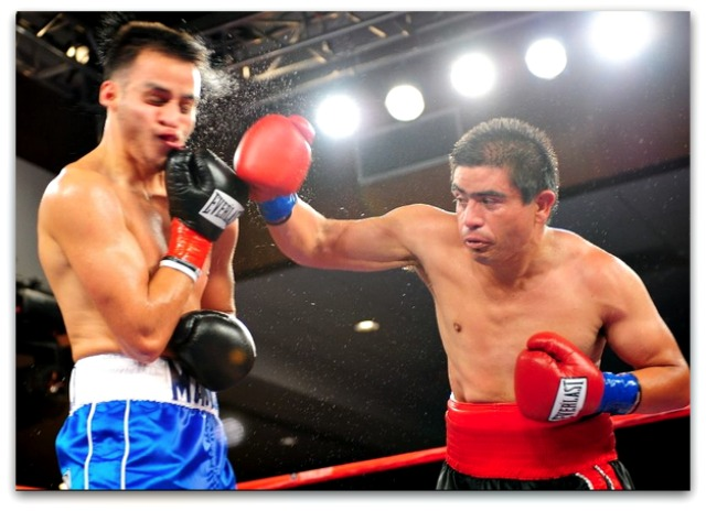 Here we see one of the rare occasions when super bantamweight Christopher Martin (l) received a direct hit from his opponent Jose Luis Araiza.