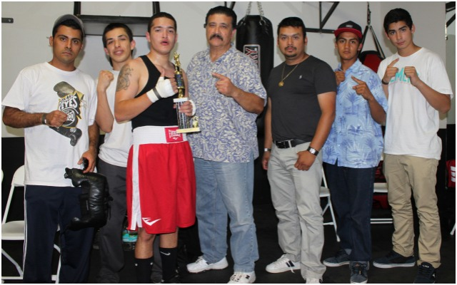 On Saturday, October 12, 2013, Ruben Valdovinos, joined here by his coach Tony Contreras and mates from the North County gym, was stellar his Amateur debut at the latest USA Amateur boxing show at the Intensity MMA gym in South San Diego.  All photos: Jim Wyatt