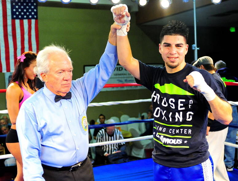David Barragan of Paradise Hills in San Diego, CA has his arm raised by Hall of Fame referee Pat Russell after defeating the game Matt Dumai from North Hollywood in Los Angeles, CA on Thursday evening at the Four Points By Sheraton Hotel in San Diego.