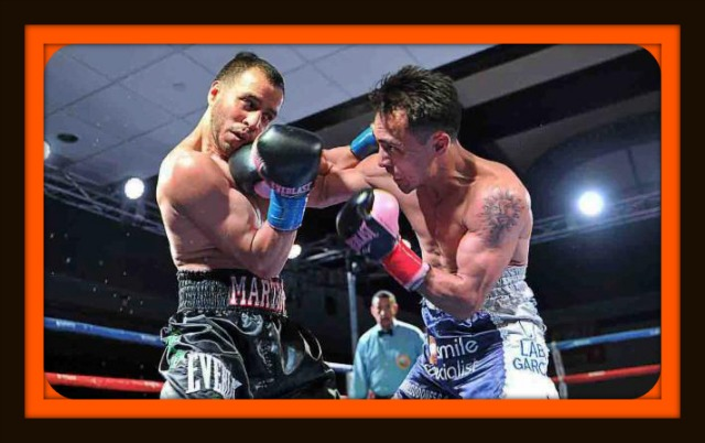 Here we see Chris Martin of Chula Vista, CA on the receiving end of a right cross to his chin from the upset minded Enrique Quevedo from San Pedro, CA. Photo: Carlos Baeza/Thompson Boxing Promotions