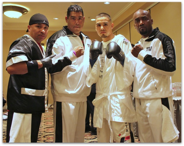Boxer Smokin' Joe Perez of San Diego poses for a photo with his trainer and support staff just prior to his match with Victor Capaceta of Tijuana. Photo: Jim Wyatt
