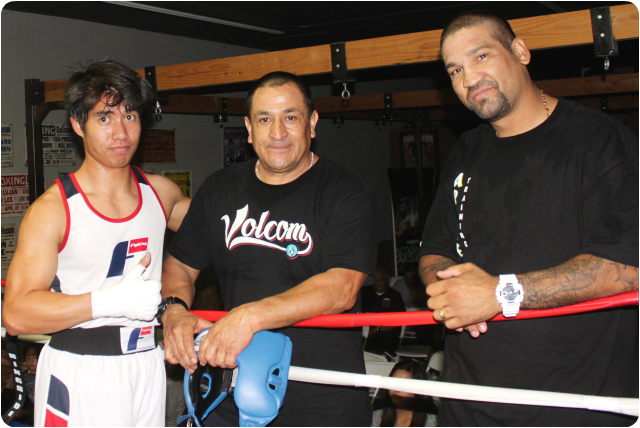 "Years down the road, Hai Tran will be able to show his grand children this photo and brag. ""Yes, I did box for a while. Here's a photo with Coaches Santillan, the father of pro boxer Giovani Santillan and ex-champ Danny Perez."