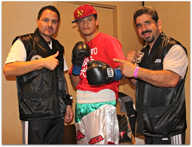 "In the dressing area before his bout with Levan ""the Wolf"" Ghvamichava of Poti, Georgia, Victor ""Sina"" Fonseca (center) poses for a photo with his coaches/co-managers Luis Lorenzo (r) and Gabriel Quinones (l). Photo: Jim Wyatt"