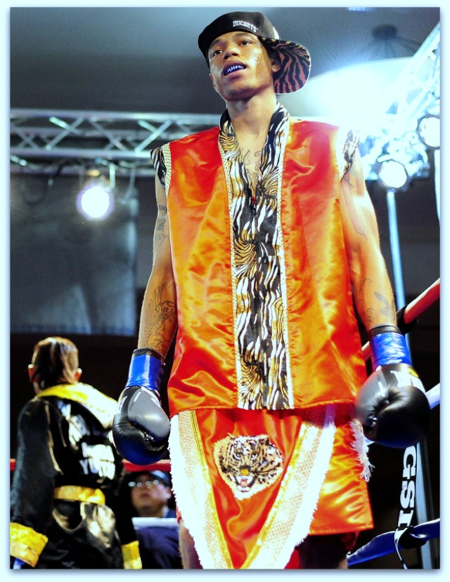 "The five action photos above plus this photo of Prince ""Tiger"" Smalls making his entrance into the ring were taken by sports photographer Paul Gallegos."