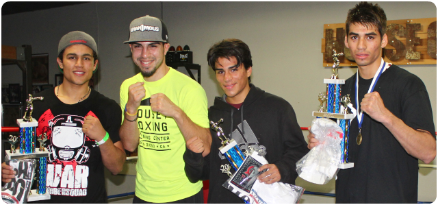(second from the left) Pro boxer and House of Boxing co-owner, David Barragan, co-owner of the House of Boxing in Paradise Hills, a neighborhood in the southeastern end of San Diego, poses his top performers (l to r) Gabrile Hernandez, Fabian Zarco and Jorge Garcia. Photo: Jim Wyatt