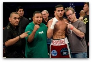 Saul Benavidez poses for a photo with his support staff which includes his father, Saul Benavides Sr. and Freddie Roach (r).