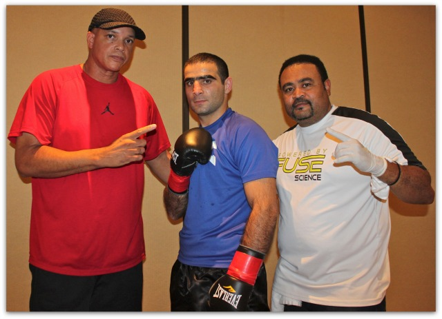 Just prior to his match with Victor Fonseca, Levan Ghvamichava (c) poses for a photo with his trainer Virgil Hunter and cornerman. Photo: Jim Wyatt