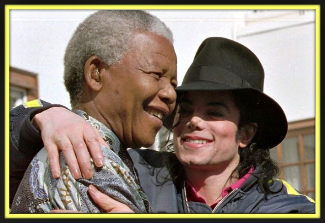 Michael Jackson hugs Mandela at the conclusion of a brief meeting on July 20, 1996.  Photo: Adil Bradlow, AP
