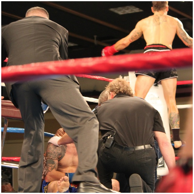 With Joe Davidson still down on the canvas, Bryce Krause (top right) is seen high up on the ropes celebrating his KO victory.