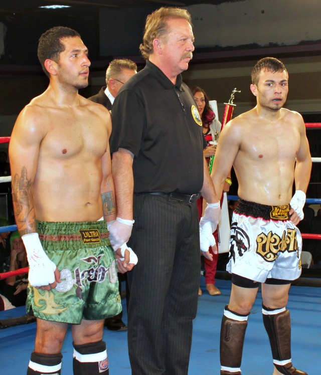 """At the conclusion of their match Seferino """"Sef"""" Ramos (r) and Jorge Poveda (l) await the judges' scores with veteran referee/judge Kris Adrian. All photos: Jim Wyatt"""