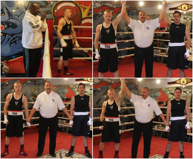 At the conclusion of their bout, Kyle Olson has his arm raised in victory by referee Hnondo Fontan.