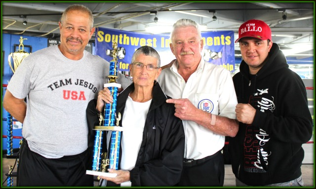 The Boxers for Christ Outstanding Official Award was presented to Melanie Ley, joined here by her husband referee Rick Ley and flanked by Jack Ballow and Robert Coons this year's organizers.