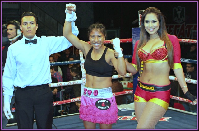 And still undefeated, Tijuana's Kenia Enriquez has her arm raised in victory by referee Cristain Curiel.