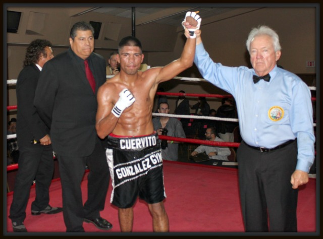 (bottom) At the conclusion of the Main Event, Fernando Garcia of Tijauna has his arm raised in victory by referee Pat Russell after he defeated Adolfo Landeros of Calexico, CA. Photo: Jim Wyatt