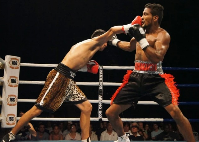 "Martin Fidel ""El Terrible"" Rios is shown landing an overhand right to the chin of Yamaguchi Falcao."