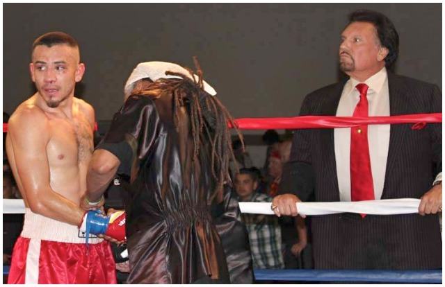While Emmanuel Robles (l) has his gloves removed by his coach Ernie johnson, Robles' manager/promoter Bobby DePhilippis (r) stands near anxious beyond words to hear if Robles has succeeded in defeating the former Olympian Yordenis Ugas. Photo: Jim Wyatt