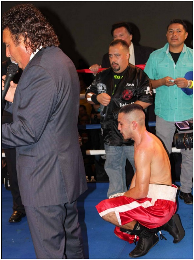 A nervous wreck, Emmanuel Robles kneels while waiting for ring announcer Benny Ricardo to announce the judges' scores. Photo: Jim Wyatt