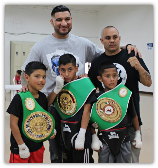 National City CYAC coach Jessie Tanner and his three students pose for a photo with the next World Champion.