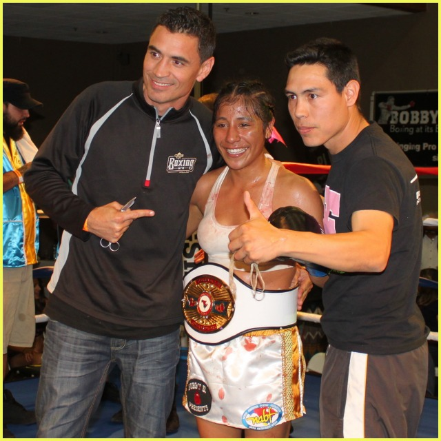 Kenia Enriquez is joined by her two trainers Gerardo Espinoza Mendoza and Vince Parra. Photo: Jim Wyatt