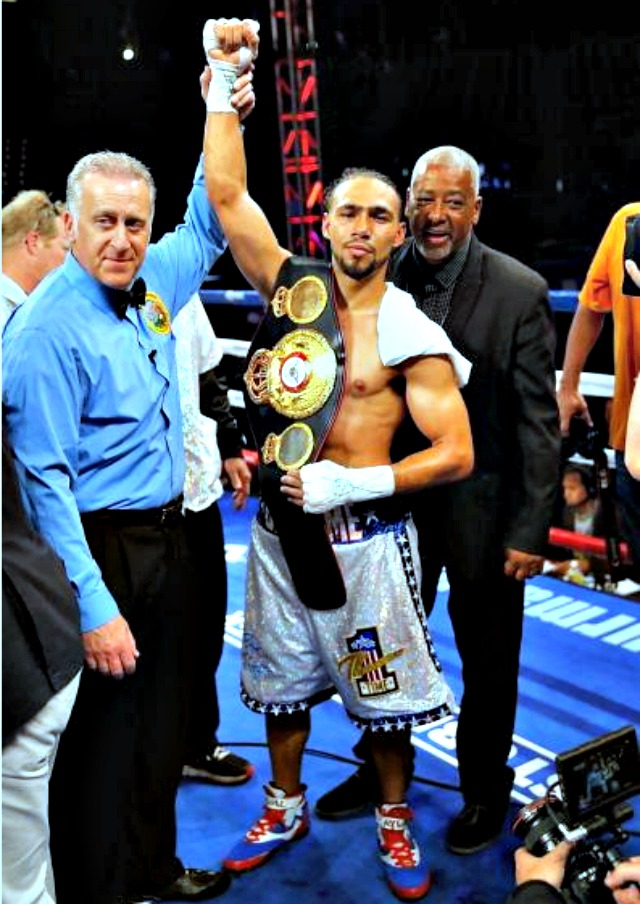 Keith Thurman has his arm raised in victory by referee Jack Reiss after he stopped Julio Diaz to win the interim WBA Welterweight Championship at the StubHub Center on April 26, 2014 in Carson, CA. Photo: Joe Scarnici/Getty Images