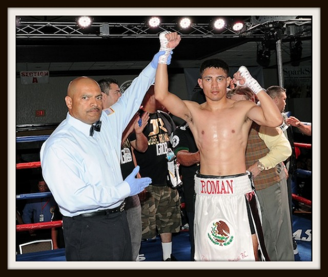 At the close of his bout versus Jose Roman has his arm raised in victory by referee . Photo: Carlos E. Baeza