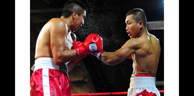 "At the Del Mar Fairgrounds on April 12, 2014, it was San Diego's Mercito ""No Mercy"" Gesta going toe to toe with the tough Edgar ""Basuras"" Riovalle of Mexico City. Photo: Paul Gallegos"
