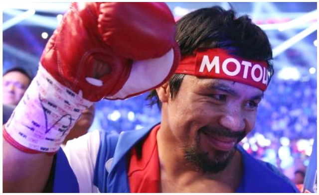 Before entering the ring, Manny Pacquiao waves to his adoring fans. Jeff Gross/Getty Images