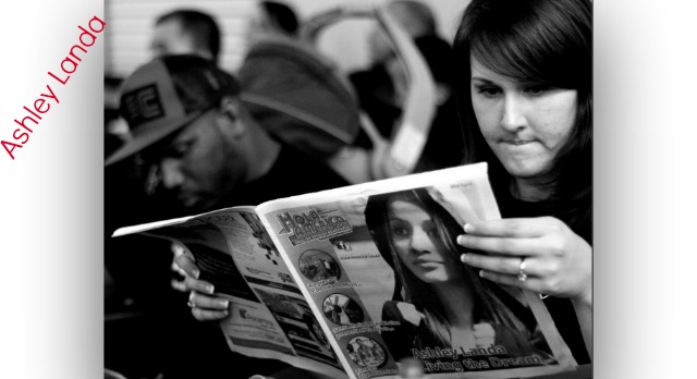 Ashley Landa has become the center of attraction in Clinton, Iowa. Here we see a resident reading about her in a local magazine.
