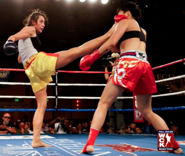 The calm before the storm. Here we see Lindsay Ball landing a kick on her opponent Wang Kehan.